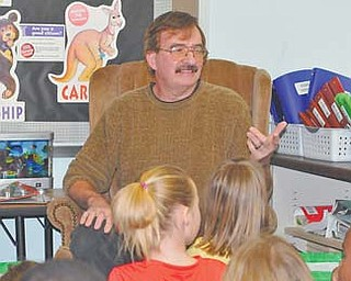 Author James Mallog of Austintown visits with second-graders at Watson Elementary School. Mallog read to the children Monday.