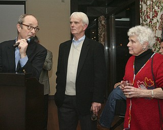 JESSICA M. KANALAS | THE VINDICATOR..Local golfer Jason Kokrak is the first Valley native in 30 years to make it to the PGA tour. Kokrak celebrated with friends and family at Trumbull Country Club. His PGA career will begin on Jan. 12. Bob Heltzel gestures to Kokrak's grandmother. Heltzel was Kokrak's coach at Warren JFK. Behind them was the team's other coach, Bob Todd.