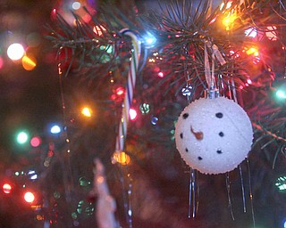 JESSICA M. KANALAS | THE VINDICATOR The Dietzes' 18-foot Christmas tree took two days to decorate completely.
