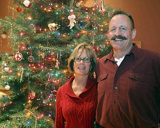 JESSICA M. KANALAS | THE VINDICATOR  Paula and Frank Dietz show off their 18-foot Christmas tree. The couple always buy a large tree, but this year's is the tallest.