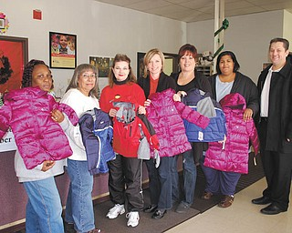 Children in the Mahoning County Head Start program received 55 brand-new winter coats through the efforts and donations of the Boardman Rotary. The third annual giveaway was organized by Rotary member Ryan Cuffle. Using creative shopping techniques, Cuffle was able to stretch the initial investment to provide an additional 25 coats.  Rotarians and Boardman High School Interact members delivered the coats to various Head Start locations throughout the county. Cuffle, far right, is shown with McCartney Road Learning Center staff, left to right: Georgetta Madison, Donna Wynn, Chrystal Wurm, Michelle Shafer, Evelyn Torres and Nichelle Moore.