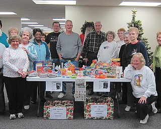 Members of the Austintown Senior Center, shown above, recently sent care packages to three Mahoning County soldiers. Items included games, cards, snacks and personal hygiene items.