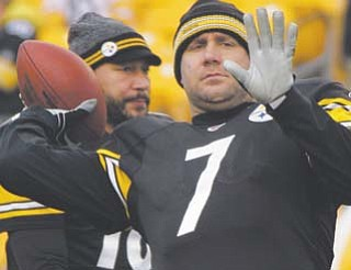 Pittsburgh Steelers quarterbacks Ben Roethlisberger (7) and Charlie Batch warm up before a game against the St. Louis Rams in Pittsburgh on Saturday.