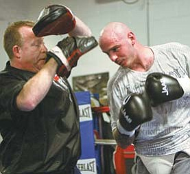 Kelly Pavlik practices for a May bout with his former trainer Jack Loew. Late in 2011, Loew and Pavlik parted ways. Pavlik ended the year facing three charges, including operating a vehicle impaired.
