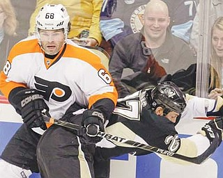 The Philadelphia Flyers' Jaromir Jagr (68) collides with the Pittsburgh Penguins' Craig Adams (27) in the first period of an NHL game Thursday in Pittsburgh. Jagr and Max Talbot, both former Penguins, each scored a goal to help lift the Flyers over Pittsburgh, 4-2.