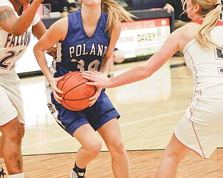 Abby Frank (34) of Poland drives the ball through Fitch defenders Aniss Hill (22) and Sarah Melfe (5) during the second period of their All-American Conference basketball game Thursday at Austintown Fitch High School. The Bulldogs downed the Falcons, 40-34.
