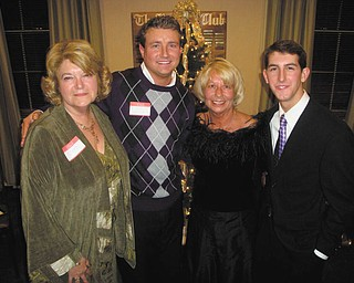 The Trumbull County Republican Party gave out awards Dec. 10 at their annual Christmas party, which took place at the Buckeye Club in Warren. Chairman Kathi Creed, second from right, presented the awards to Barbara Rosier-Tryon, left, Republican Woman of the Year; and Tom O'Neill, second from left, and Nick Santucci, right, who received Young Republican of the Year awards. Missing from the photo is Al Haberstroh, Republican Man of the Year. All recipients received letters of congratulations from Sen. Rob Portman, Gov. John Kasich and Lt. Gov. Mary Taylor.
