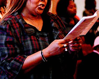 Lillian Howell of Youngstown sings along with the congregation during the service. The annual event celebrates the 1863 signing of the Emancipation Proclamation, which freed slaves in America.