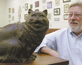 Fred Pisani, manager of the Feline Historical Museum in Alliance, oversees a collection of art and pop-culture items involving cats.