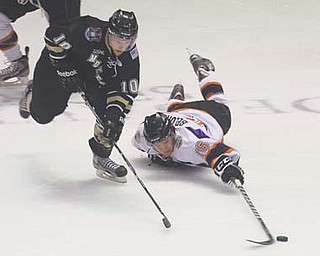 Phantoms forward Ryan Belonger (16) tries to keep Muskegon's Matt DeBlouw from the puck during Thursday's game at the Covelli Centre.