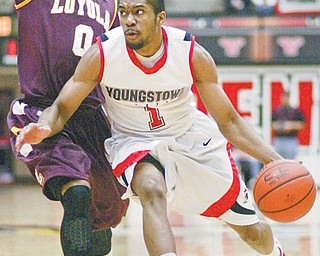 Youngstown State's Blake Allen drives around Denzel Brito of Loyola during Thursday's game at Beeghly Center. YSU won 68-64 in overtime.