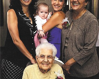 Rose Windt, seated, is with members of her family who gathered to celebrate her 100th birthday Jan. 4. From left to right are Gina McQuillan, a granddaughter; Melia Caban, a great-great-granddaughter; Jacquelyn Caban, a great-granddaughter; and Geraldine Zinghini, her daughter.
