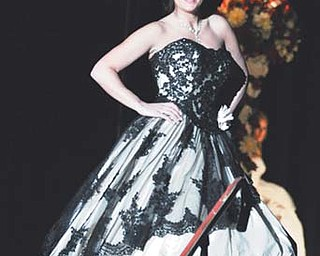 """Joy Bosiljcic models """"The Equador"""" from the Ian Stuart Killer Queen couture collection during the opening Sunday afternoon of Evaline's Bridal Show at the Covelli Centre."""