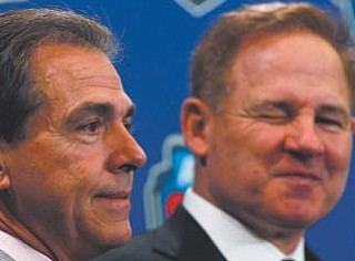 LSU head coach Les Miles, right, and Alabama head coach Nick Saban pose for a picture during a news conference for the BCS national championship game in New Orleans.