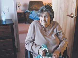 Barbara Clelind, 76, a three-year resident of Hubbard Manor apartments, enjoys the newly renovated apartment in which she lives. The 40-year-old complex is undergoing a $5.7 million renovation expected to be complete by the end of February.