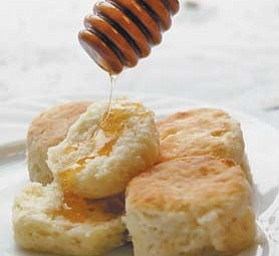 Callie's Charleston Biscuits are shown with a drizzle of honey.
