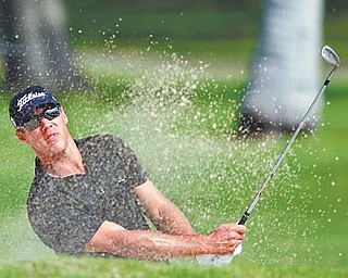 Graham DeLaet of Canada blasts out of a bunker on the 13th hole during the first round of the Sony Open golf tournament Thursday at Waialae Country Club in Honolulu, Hawaii. DeLaet shot a 7-under-63 to claim the top spot on the leaderboard.