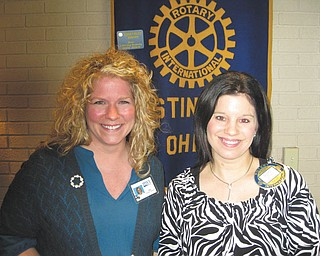 Learning about volunteers: Guest speaker for the Rotary Club of Austintown's first meeting of the new year was Amy Miklandric, coordinator of volunteers at MVI Hospice Services. Part of the organization's work is done by volunteers who provide respites for caregivers, light cooking, errands and conversation time. For more information call 330-759-9487. Rotary president Deanna Spirko, right, presented Miklandric with a certificate of appreciation and a book to be donated to the library at Woodside Elementary School.