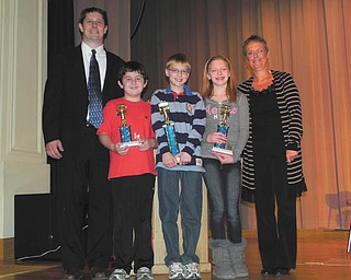 Spelling Bee winners: Roosevelt Elementary School in McDonald had its 2012 Spelling Bee on Jan. 11 at McDonald High School. Principal Dave Vecchione, left, stands with students who finished in top spots. From left to right are Jared Helco, third place; Braden Rupe, first place; and Abbie Matig, second place. Spelling Bee instructor Martha Justice is at far right. This is the second consecutive year that Braden has finished in first place.