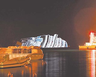The cruise ship Costa Concordia leans on its side Monday after running aground near the tiny Tuscan island of Giglio, Italy, last Friday. The rescue operation was called off midafternoon Monday after the Costa Concordia shifted a few inches in rough seas. The fear is that if the ship shifts significantly, some 500,000 gallons of fuel may begin to leak.