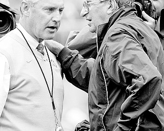 In this Sept. 23, 2006 file photo, Ohio State head coach Jim Tressel, left, and Penn State head coach Joe Paterno meet on the field before an NCAA college football game at Ohio Stadium in Columbus, Ohio. The Two schools meet on Saturday, Oct. 25, 2008 in Columbus. (AP Photo/Kiichiro Sato, File)