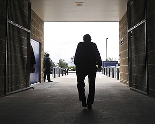 In this Oct. 5, 2010 file photo, Penn State  football coach Joe Paterno leaves Beaver Stadium after his weekly NCAA college football news conference on Tuesday, Oct. 5, 2010 in State College, Pa.  Paterno, the longtime Penn State coach who won more games than anyone else in major college football but was fired amid a child sex abuse scandal that scarred his reputation for winning with integrity, died Sunday, Jan. 22, 2012. He was 85. (AP Photo/Pat Little, File)