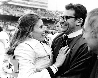 Penn State football coach Joe Paterno is embraced by his wife, Sue, following Penn State's victory over Texas in the Cotton Bowl in Dallas, Tx., on Jan. 1, 1972.  The Lions beat the Longhorns 30-6.  (AP Photo)