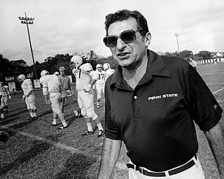 Penn State head football coach Joe Paterno is shown on the field as his team starts a drill session in New Orleans, La., Dec. 29, 1983.  The Nittany Lions meet Georgia in the Sugar Bowl for the national title Jan. 1.  (AP Photo/Jack Thornell)