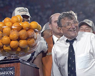 Former Penn State head coach Joe Paterno, seen in this 2006 file photo after the Nittany Lions defeated Florida State in the Orange Bowl, died Sunday, January 22, 2012. He was 85. (Clem Murray/Philadelphia Inquirer/MCT)