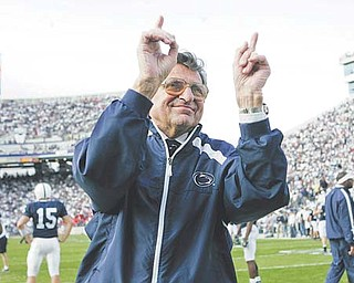 Penn State football coach Joe Paterno acknowledges the crowd during warm-ups before a game in State College, Pa. Paterno, who in his 62 years with the Nittany Lions won more games than any other major college coach, died Sunday. He was 85.