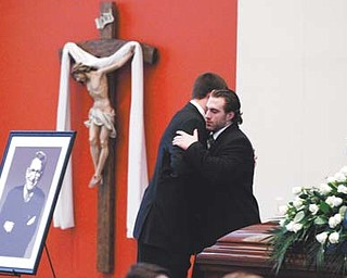 Michael Zordich, right, a former Cardinal Mooney standout, embraces fellow Penn State football player Kevin Blanchard as he replaces Blanchard as an honor guard in the Pasquerilla Spiritual Center on the Penn State campus for the viewing of former Penn State coach Joe Paterno on Tuesday in State College, Pa. Paterno died Sunday morning.