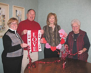 Decorating for dinner: Eileen and Ray Novotny, left, Joan Sonnett and Sister Nancy Dawson, right, general superior of the Ursuline Sisters of Youngstown, ready decorations for the Ursuline Center's annual Valentine's Day dinner scheduled for 6:30 p.m. Feb. 14 in the center's auditorium, 4280 Shields Road, Canfield. Entertainment will be offered by the Canfield High School Music Trio. Tickets are $20, and proceeds will benefit various ministries offered by the Ursuline Sisters. For tickets or more information, call Peggy Eicher at 330-533-7681 or e-mail her at peggyeicher@gmail.com.