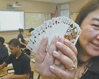 Jane Haggerty, math coach at P. Ross Berry Eighth and Ninth Grade Academy in Youngstown, uses an ordinary deck of playing cards to help students improve their math skills. The playing cards were on her teacher wish list.