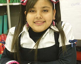 Aleishka Rodriguez, a fourth-grader at Youngstown's Martin Luther King Jr. Elementary School, enrolled in the school as a second-grader speaking Spanish. Now, with help from her teacher, Joan Fahey, others at the school and family members, Aleishka speaks English fluently. About 250 students participate in the city schools' English language learners program for students who speak other languages.