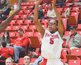 Youngstown State senior guard Kenya Middlebrooks (5) goes up for a shot during an Horizon League basketball game Thursday against Detroit at YSU's Beeghly Center. The Penguins dropped the Titans, 80-67, behind Middlebrooks, who scored a career-high 30 points, including a school-record eight 3-pointers.