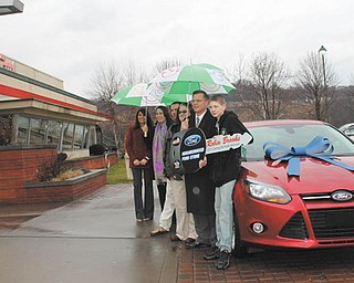 Austintown residents Ron and Robin Brooks won a new 2012 Ford Focus, which was presented to them in Pittsburgh on Jan. 17. Eat'n Park Restaurants and the Neighborhood Ford Store teamed up for the presentation, a result of Eat'n Park's Caring for Kids Campaign, which raised money for children's hospitals and children's charities in Pennsylvania, Ohio and West Virginia. The Ford raffle raised more than $140,000 for the campaign. The Brookses' winning ticket was drawn Dec. 14 by a patient at Children's Hospital of Pittsburgh from more than 70,000 tickets sold. The new car will replace the Brooks family's minivan, which has racked up more than 250,000 miles. Ron Brooks will use the Focus for his weekly drives to the Cleveland Clinic, where he receives medical treatment. The Neighborhood Ford Store, which comprises 82 Ford Dealers in Southwest Pennsylvania, southeast Ohio and the panhandles of Maryland and Virginia, donated the Focus this year. They also donated a new Ford for last year's Caring For Kids Campaign.