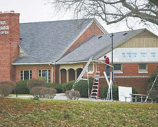 Henry Stambaugh Golf Course is getting a much-needed face-lift thanks to the work of Boak & Sons of Austintown. Here, Jason Thompson works on the side of the clubhouse.