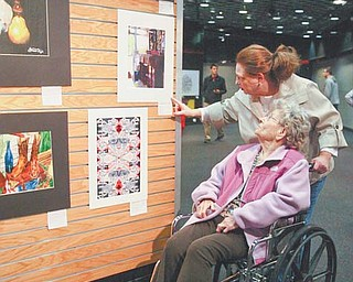 Lydia Cherep Becker, guidance counselor at Bristol High School, shows her mother, Mary Cherep, some of her students' work at the Art Outreach Gallery in Eastwood Mall in Niles. Entries into the 2012 Northeastern Ohio Regional Scholastic Art Awards are on display.