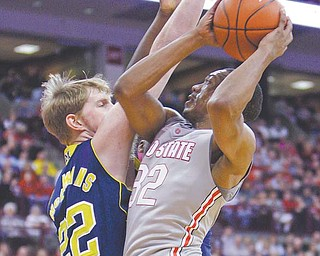 Ohio State's Lenzelle Smith Jr., right, shoots over Michigan's Blake McLimans during the second half of an NCAA college basketball game Sunday in Columbus. Smith scored 17 points and had a career-high 12 rebounds as the Buckeyes defeated the Wolverines 64-49.