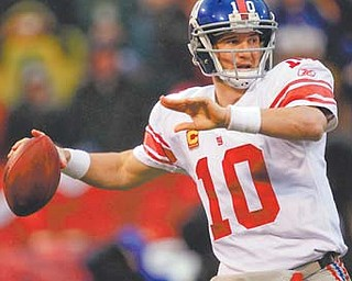 New York Giants quarterback Eli Manning throws during the first half of the NFC Championship against the San Francisco 49ers in San Francisco.