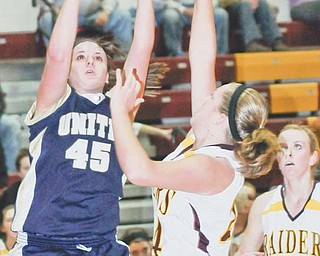 United's Taylor Smith (45) shoots over South Range's Kristin Robinson (24) while Kelsey Maynard watches during Monday's game at South Range High.