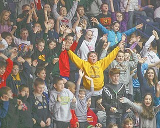 Pupils from St. Christine Elementary School in Youngstown cheer on the Youngstown Phantoms during an