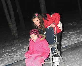 Annika Lazazzera, 10, helps out her little sister, Carlie, 4, after a long day of ice skating at their Uncle Don's ice rink. Photo taken by their mom, Mindy Lazazzera of Canfield.