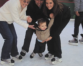 Evan Dunn, a first-time skater at 22 months, gets a little help from his parents, Jamie and Kelly Dunn of Tempe, Ariz., (formerly of Liberty and Canfield) and his Gran, Lynn Dunn of Liberty. Photo was taken by Evan's Papa, Dave Dunn. Evan is also the grandson of Bob and Eileen Leonard of Canfield.