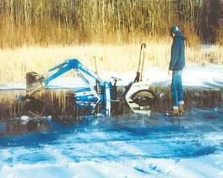 Twenty years ago, Frank Hoffman of North Lima was clearing off his neighbor's pond so his children could ice-skate. The pond was frozen, except for one edge. The ice began to crack and Frank's brand-new tractor began to sink, much to his horror. Photo submitted by Frank's wife, Victoria Hoffman.