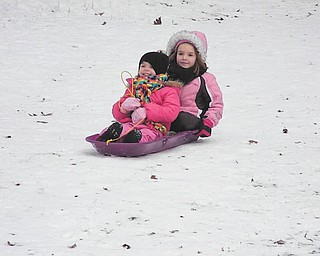 "It""s the first time sled-riding for Mia, 5, and Carlie, 4, Lazazzera of Canfield. They were at the bike trail in Mill Creek Park. Photo taken by their mother, Mindy Lazazzera."