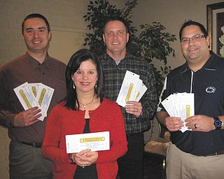 Rotary's Reverse Raffle: The Rotary Club of Austintown will have its annual Reverse Raffle March 10 at the Maronite Center, and members are preparing for this major fundraiser. The club sponsors a number of local, national and international projects to serve the community. Local projects include Woodside Reads literacy tutors, library book purchase programs, dictionaries for all third-graders in Austintown and Jackson Milton, scholarships for Fitch High School students and support of Fitch Interact Club. The evening fundraiser will feature dinner, cocktails, a money raffle, dancing, and basket auction. Tickets cost $150 per couple. Here, four members gear up for their sales. In front is President Deanna Spirko, and in back, from left to right, are Treasurer Brian Frederick, Dave Buttar and Dr. Michael Cafaro.