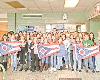 It's a banner day! Columbiana County Recorder Craig Brown, in the middle, recently presented state of Ohio flags to social studies classes at Westgate Middle School in East Liverpool. Fifth- and sixth-graders welcomed him along with Mrs. Shari Voltz, at left, and Mrs. Vicky Pearson, far right.