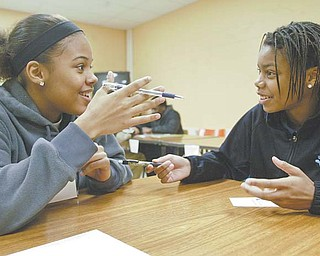 Brae Hudson, left, and Chmicka Kennedy, juniors at Choffi n Career and Technical Center in Youngstown, participate in Junior Achievement of Mahoning Valley's Success Skills program Wednesday at the school.