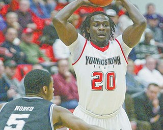 Youngstown State's Nate Perry shoots past Butler's Ronald Nored during a game last season at YSU's Beeghly Center. The Penguins lost to the Bulldogs on the road in January at Hinkle Fieldhouse in Indianapolis, but they are looking to even the series tonight when Butler returns to Beeghly.